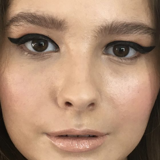 Lucy- graphic liner, glossy skin and nude, glossy lip.